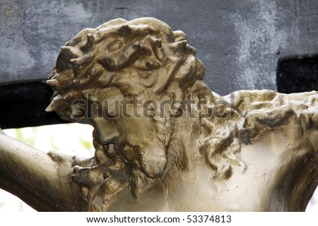 Ancient gold Jesus on a old Prague Cemetery - stock photo