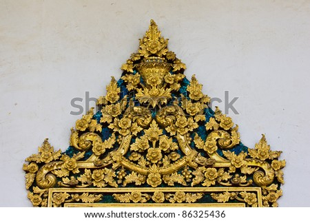 ancient gold pattern by Thai style on top of widows at Buddha church Thailand