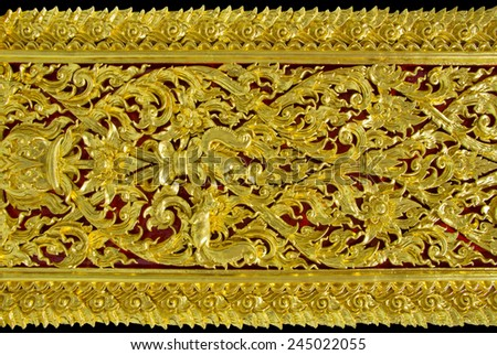 Ancient golden carving wooden in Thai temple. Thailand - stock photo