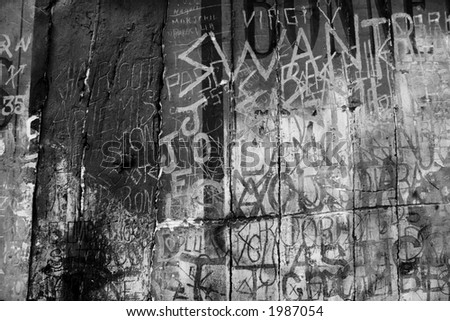 Ancient graffiti etched in to plaster wall. Monochrome. Gritty looking design background for that grunge look. - stock photo