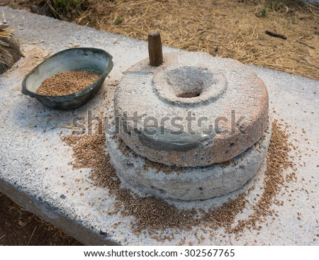 Ancient grain hand grinding millstones - stock photo