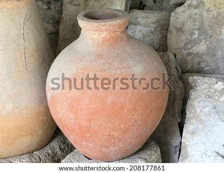 Ancient greek amphoras in a museum of Chersonese Taurian - stock photo