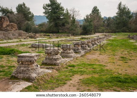 Ancient Greek ruins at the archaeological place of Ancient Olimpia, Cyclades, Greece