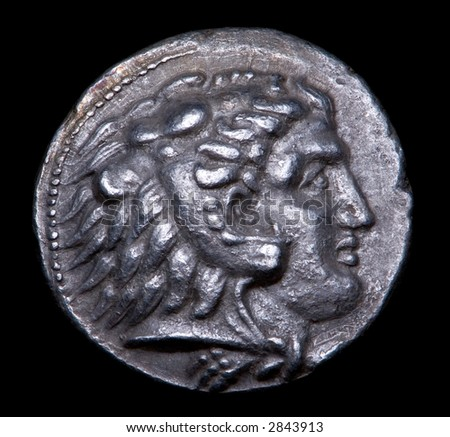 Ancient Greek Silver Coin with Alexander The Great - stock photo