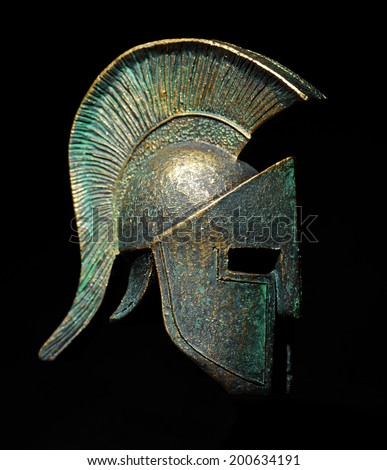 Ancient greek sparta style helmet on black background, studio shot - stock photo