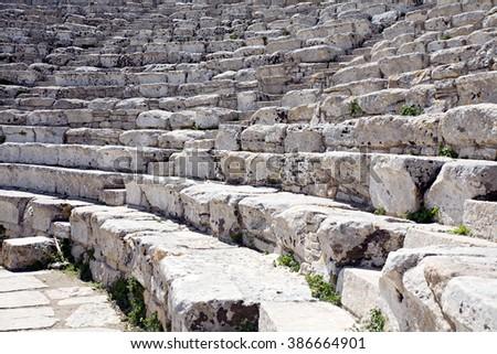 ancient Greek stone amphitheatre ruins closeup view - stock photo