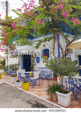 Ancient Greek streets Beautiful cozy courtyards. vacation in Greece - stock photo