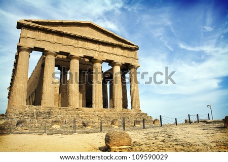 Ancient Greek temple in the Valley of the Temples in Sicily, Italy, near Agrigento. The area was included in the UNESCO Heritage Site list in 1997 - stock photo