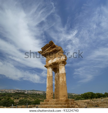 Ancient Greek Temple of the Dioscuri (V-VI century BC), Valley of the Temples, Agrigento, Sicily. The area was included in the UNESCO Heritage Site list in 1997 - stock photo