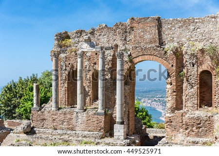 Ancient Greek theater of Taormina city with a by look at the Sicilian island and the Mediterranean Sea
