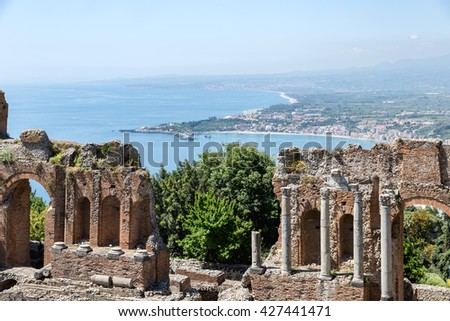 Ancient Greek theater of Taormina city with a panorama southward at the Sicilian island and the Mediterranean Sea - stock photo