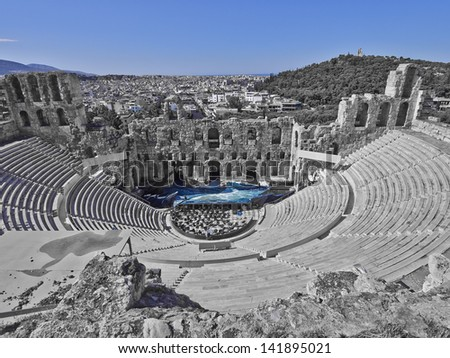 ancient Greek theatre under Acropolis of Athens, Greece, in b/w and blue - stock photo