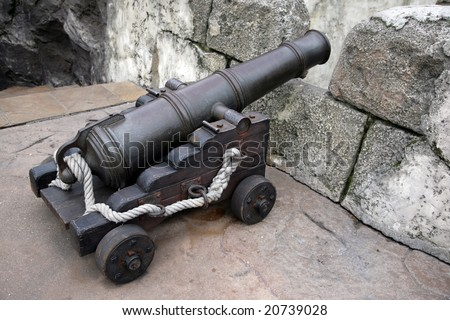 Ancient gun on a wooden skeleton in a fortress