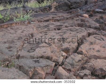 Ancient Hawaiins left their imprint through these petroglyphs. - stock photo