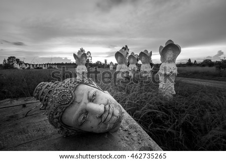 Ancient Head Buddha statue at sunset