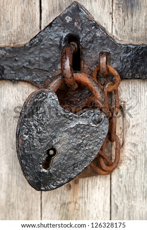 Ancient heart shaped padlock on the door of Caenarfon Castle, North Wales - stock photo