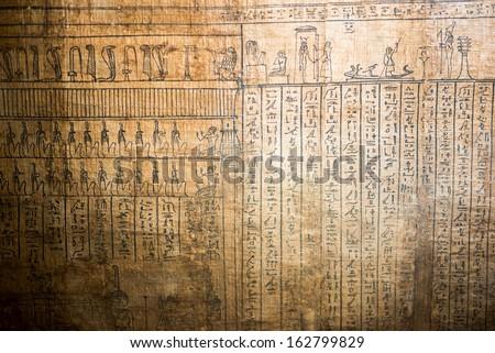 Ancient Hieroglyphics on papyrus - stock photo