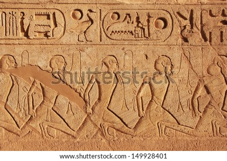 Ancient hieroglyphics on the wall of Great temple of Abu Simbel, Nubia, Egypt - stock photo