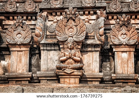 Ancient Hindu temple with deities and mythological creatures statues in Hampi, Karnataka, India - stock photo
