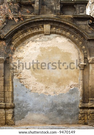 Ancient immured arch within old shell rock wall - stock photo