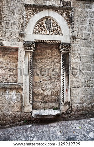 Ancient immured arch within old wall. Korcula. Croatia. - stock photo