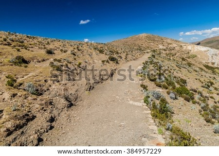 Ancient Inca trail at Isla del Sol (Island of the Sun) in Titicaca lake, Bolivia - stock photo