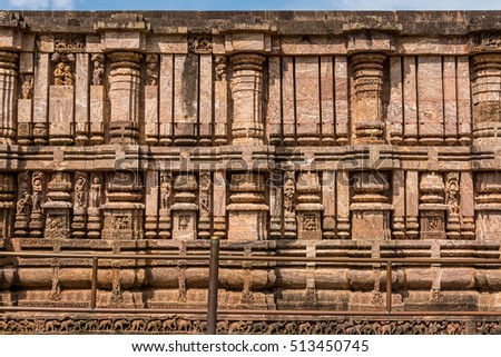 Ancient Indian delicate architecture patterns over sandstone at Konark temple