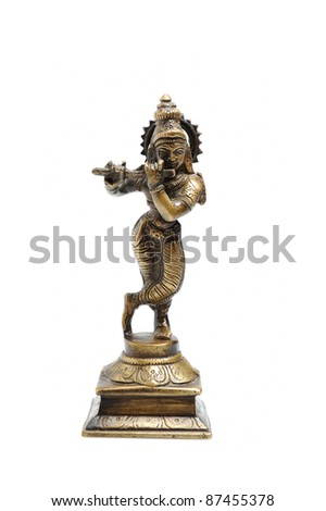 Ancient indian figure of Krishna God isolated - stock photo