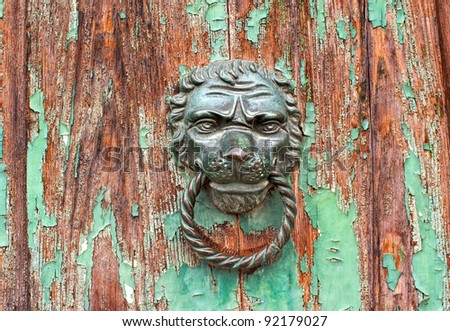 Ancient iron lion head door knob - stock photo