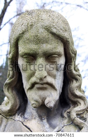 Ancient Jesus on a old Prague Cemetery - stock photo