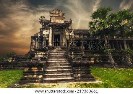 Ancient Khmer architecture. Amazing view of Angkor Thom temple at sunset. Angkor Wat complex, Siem Reap, Cambodia travel destinations - stock photo