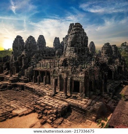 Ancient Khmer architecture. Amazing view of Bayon temple at sunset. Angkor Wat complex, Siem Reap, Cambodia travel destinations - stock photo