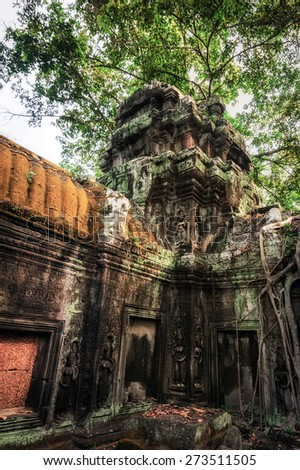 Ancient Khmer architecture. Ta Prohm temple with giant banyan tree at Angkor Wat complex. Siem Reap, Cambodia - stock photo