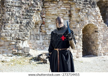 Ancient knight in metal armor - stock photo