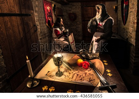 Ancient knights in metal armors in palace - stock photo