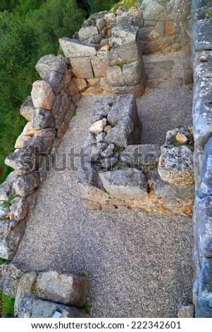 Ancient labyrinth guarding the entrance to a temple, Greece - stock photo