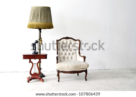 ancient leather sofa and telephone in white room - stock photo