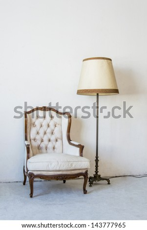 Ancient leather sofa in white room - stock photo
