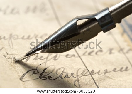 Ancient letter written by beautiful handwriting and an ink feather - stock photo