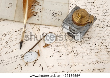 ancient letters with  eyeglasses and feather