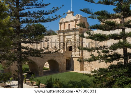 Ancient limestone Bridge and Gateway into city of Mdina, Malta, Europe, viewed from the ditch.