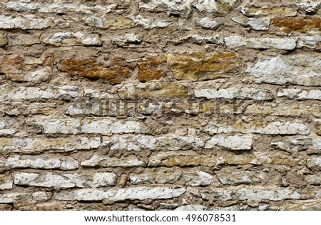 Ancient limestone wall background.