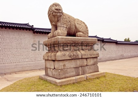 Ancient lion-like sculpture near the entrance to the Gyeongbokgung Royal Palace in Seoul, South Korea - stock photo