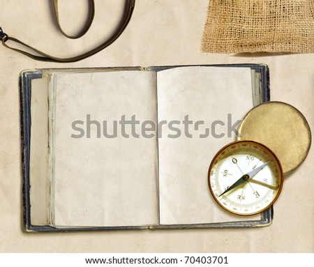 ancient logbook and compass on faded paper, copyspace - stock photo
