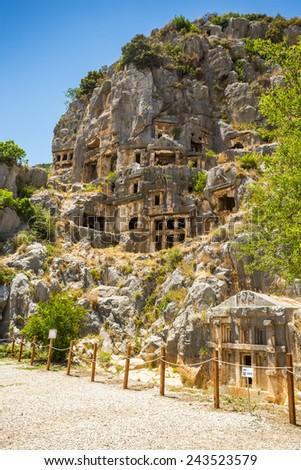 Ancient lycian Myra rock tomb ruins at Turkey Demre - stock photo