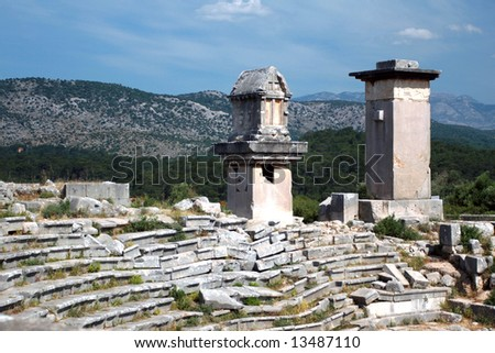 ancient lykia tombs near an ancient theater - stock photo