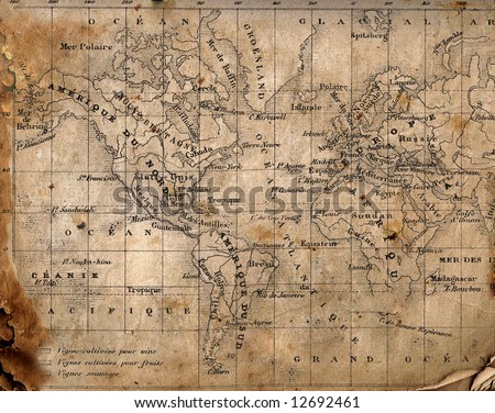 Ancient map of the world. The torn, scorched edges. - stock photo