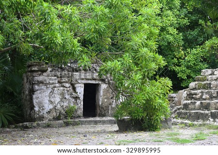 Ancient Maya city in Xcaret - stock photo