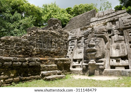 Ancient Maya Mask Temple located in the jungle of Belize. - stock photo