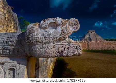 Ancient Mayan civilization historical ruins at night. Kukulcan Temple at Chichen Itza, Yucatan, Mexico. Fantasy. - stock photo